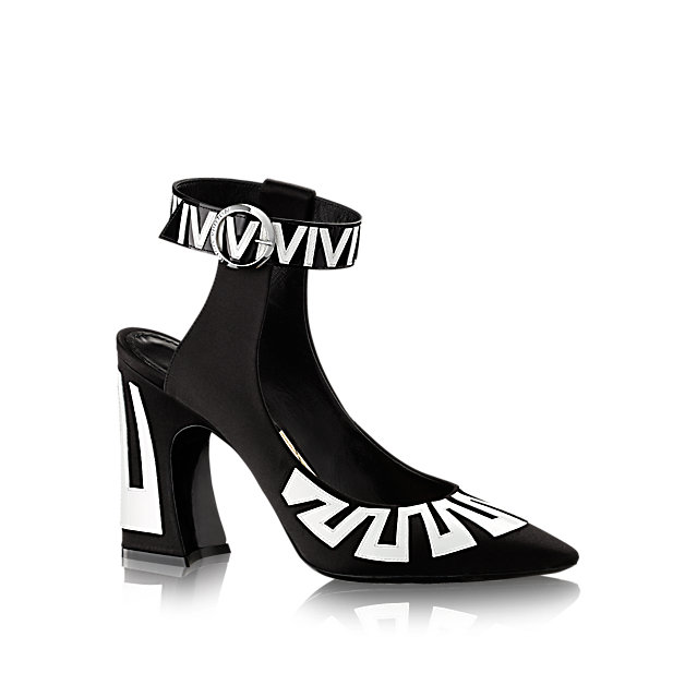 One of the standout styles of Louis Vuitton's 2015 Cruise collection, this open-back pump in satin and patent calf leather interprets its graphic black and white theme through embroidery on the upper, lacquer on the chunky heel, and a crisscross pattern on the insock.