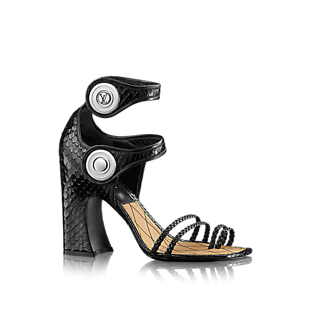 One of the statements of Louis Vuitton's 2015 Cruise collection, this striking sandal in luxurious python skin is characterized by its double ankle strap, outsize LV-engraved snap fasteners, and high, chunky heel.